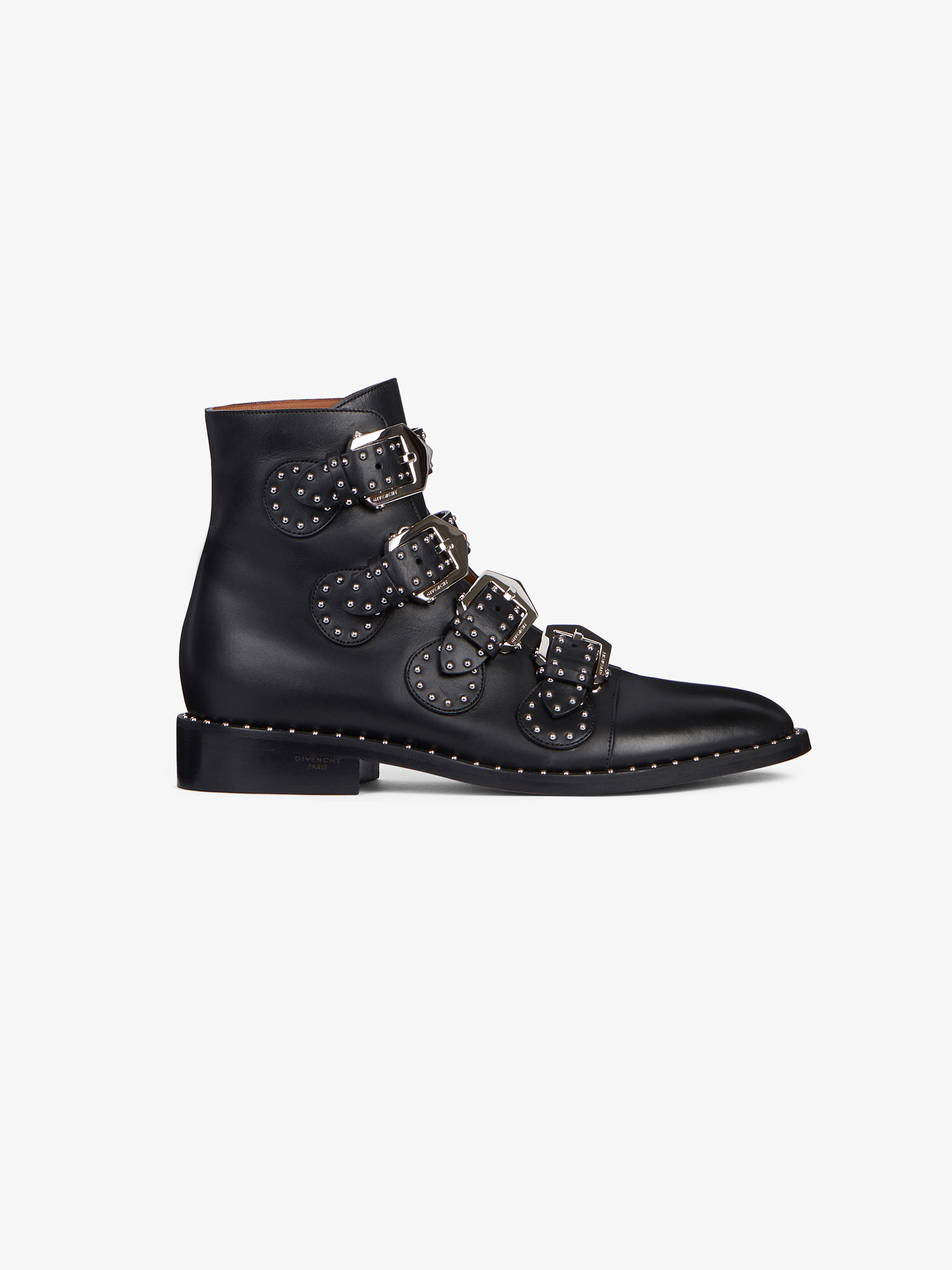 Buckled ankle boots in leather with studs