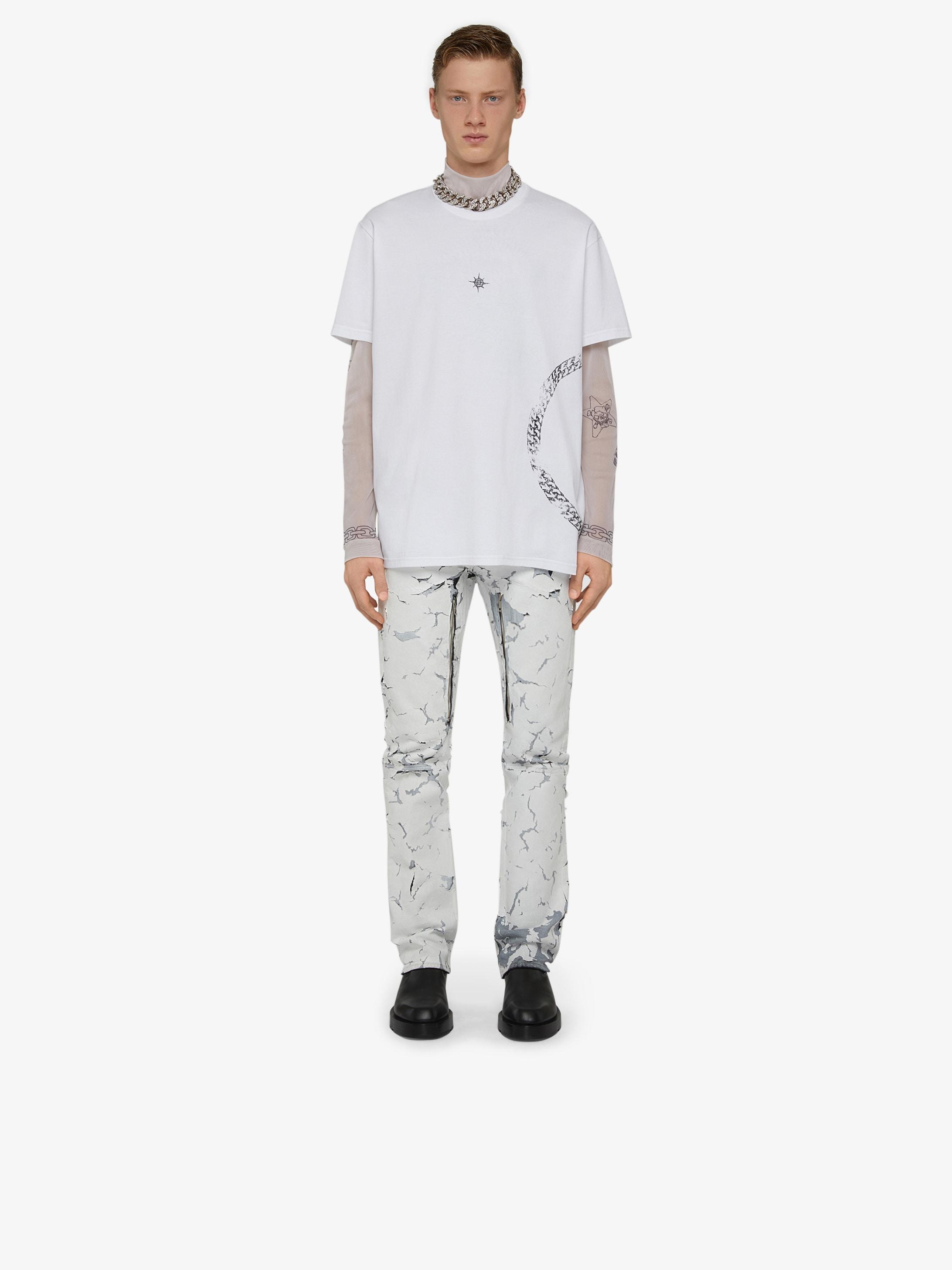 Jeans tinti craquelé con zip