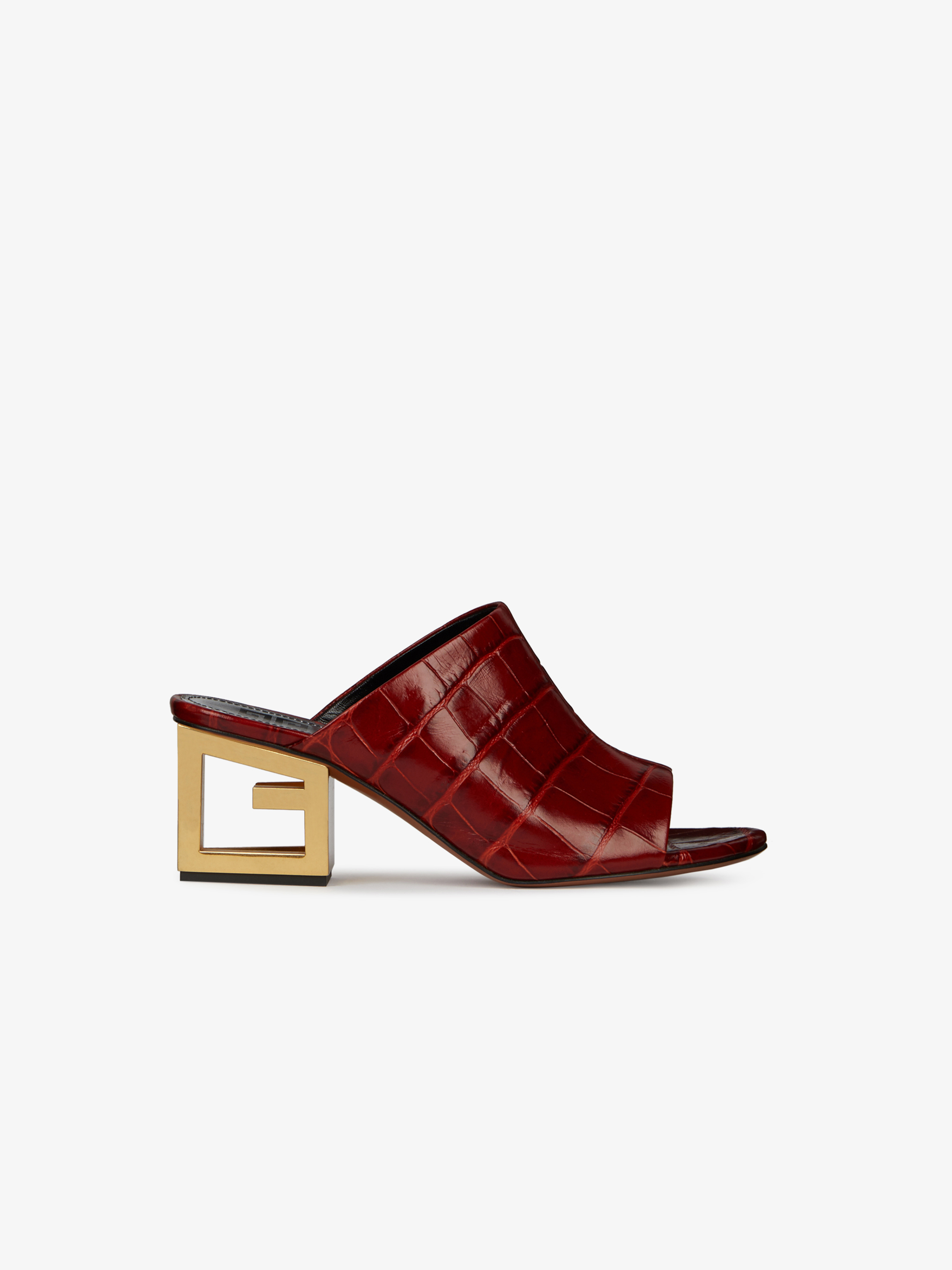 Mules in crocodile-effect leather with triangular G heel