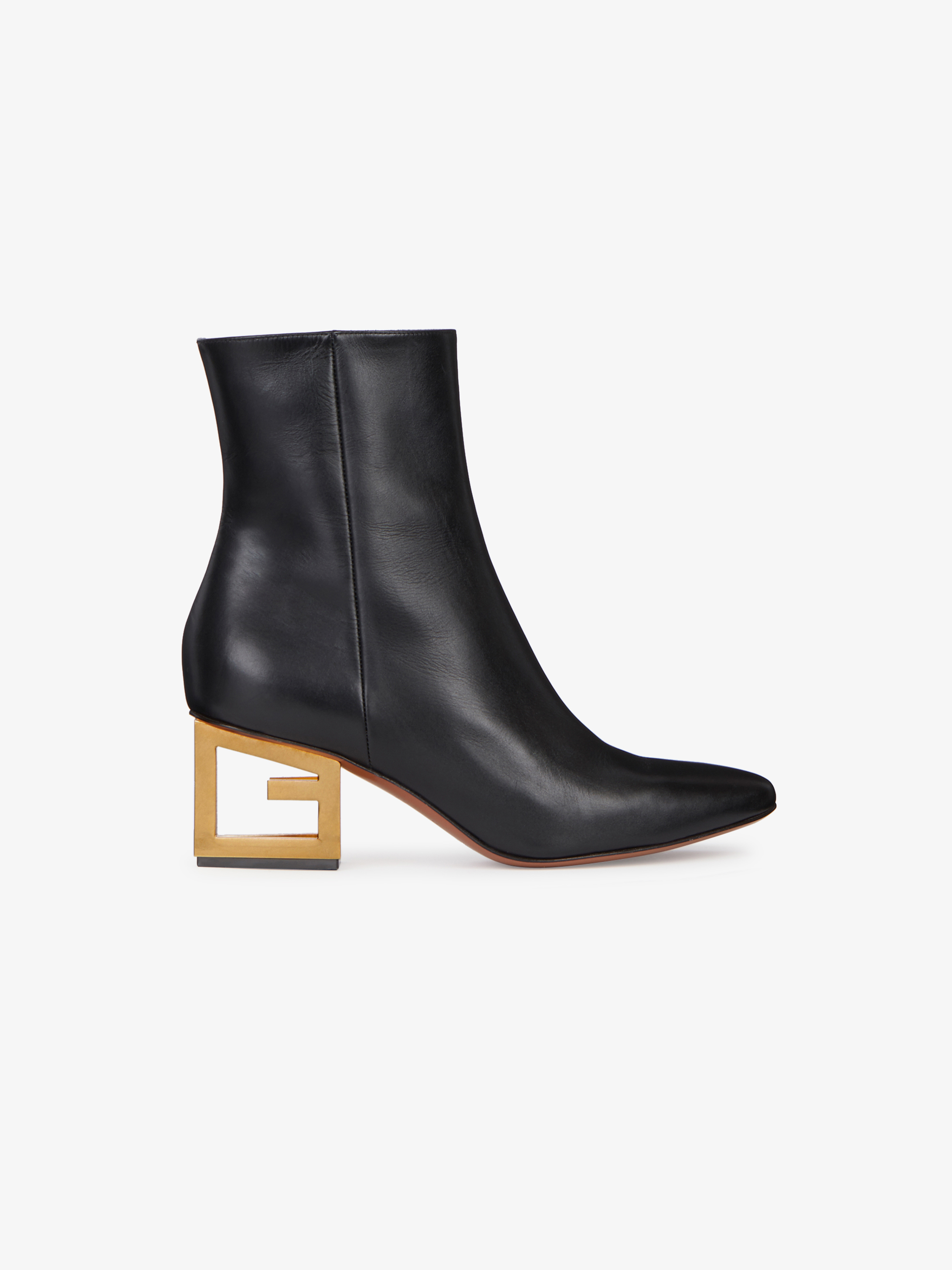 Ankle boots in leather with triangular G heel