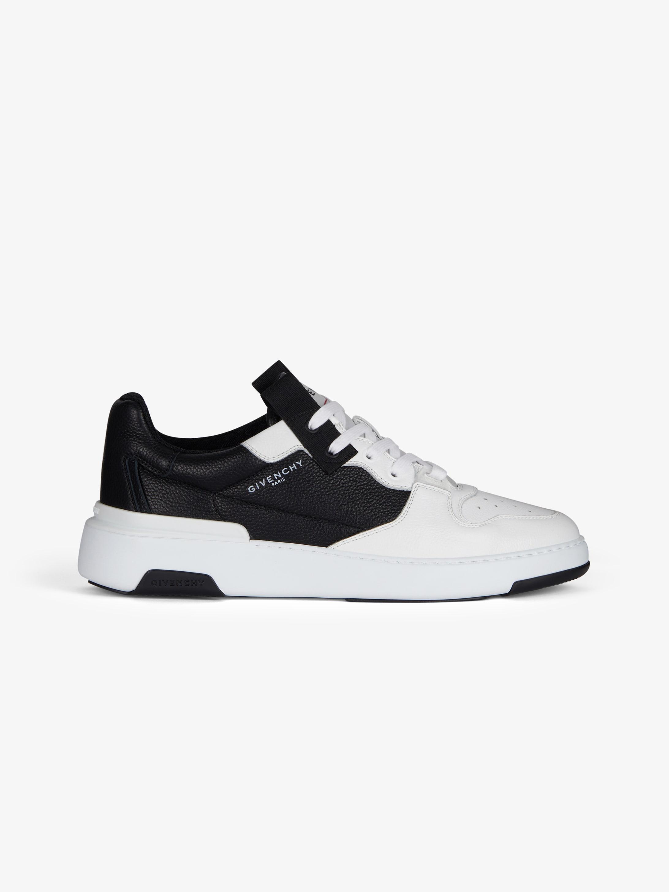 Wing low asymmetric sneakers in leather
