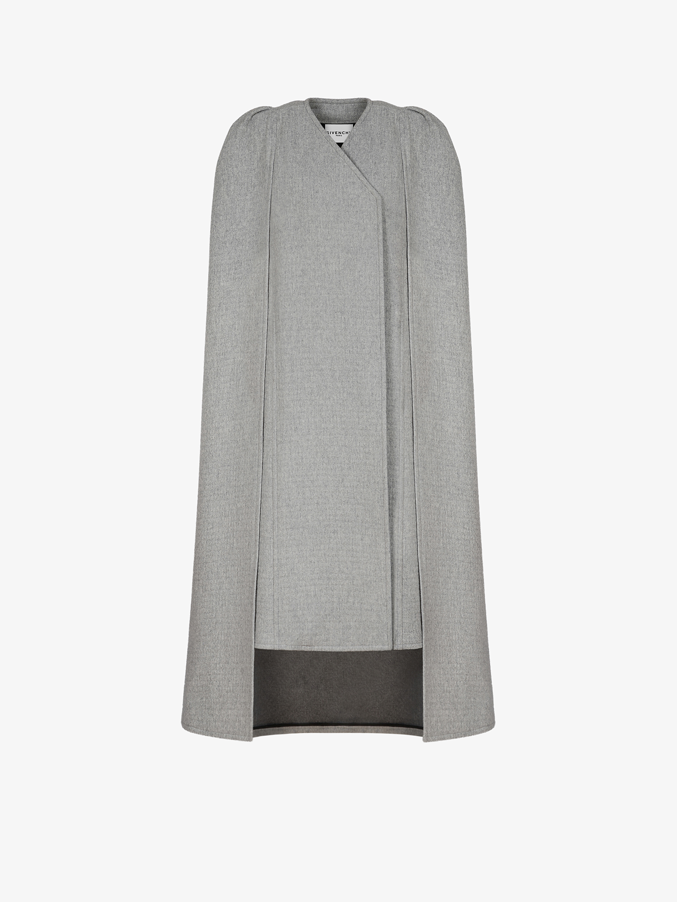 Coat in wool with cape