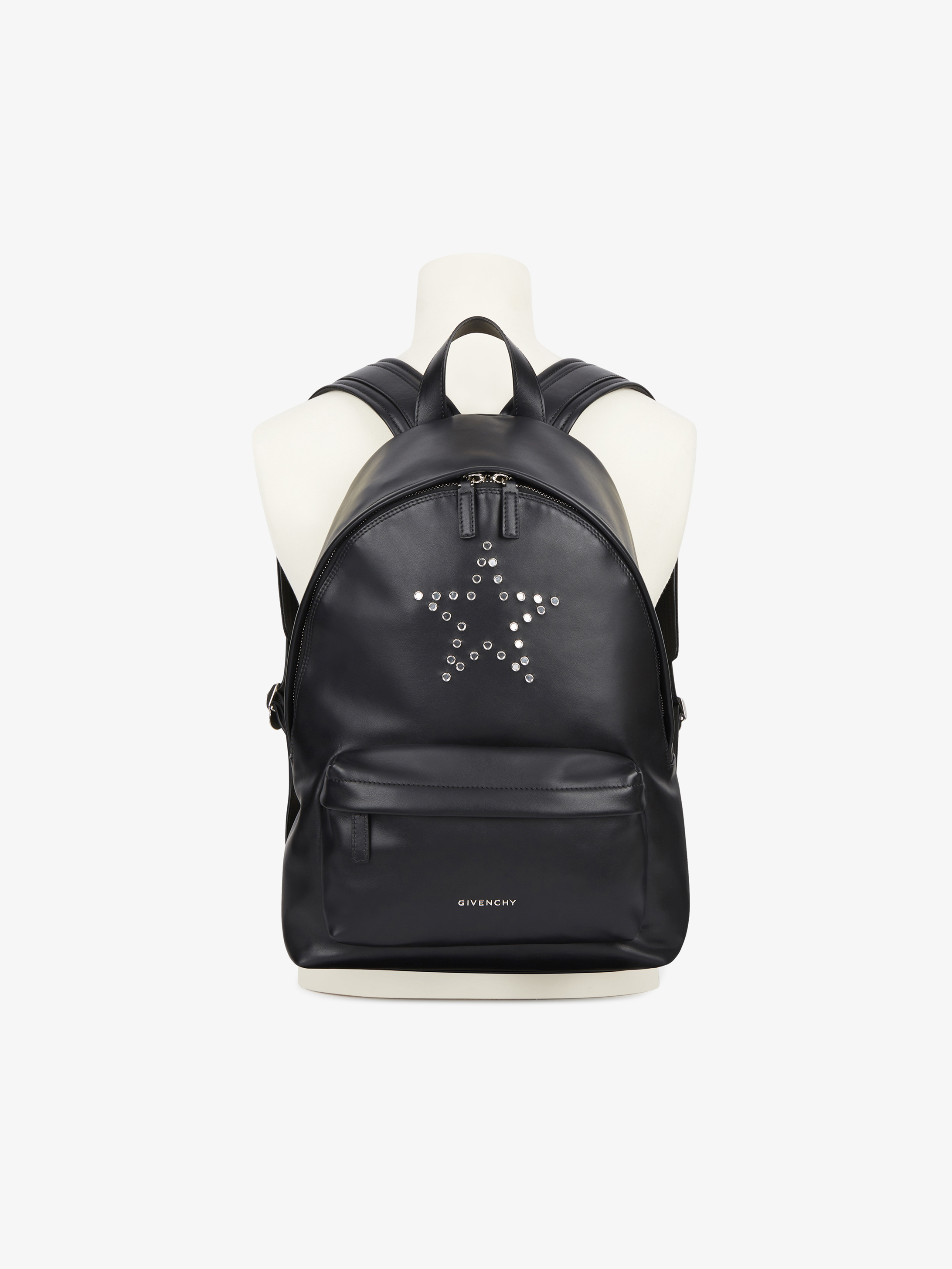 Mirror rivets on leather backpack