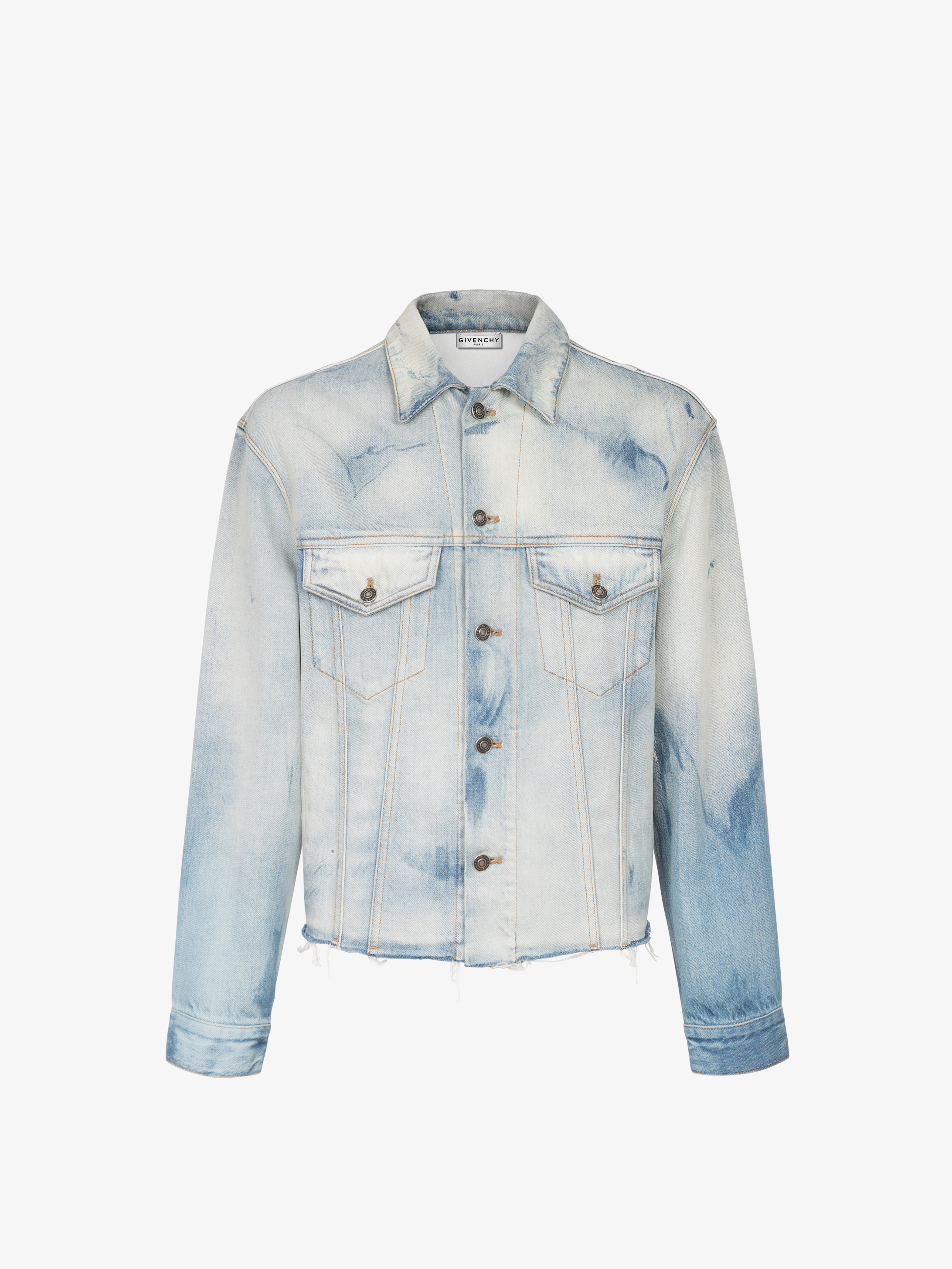 Jacket in washed-out denim with raw cuts