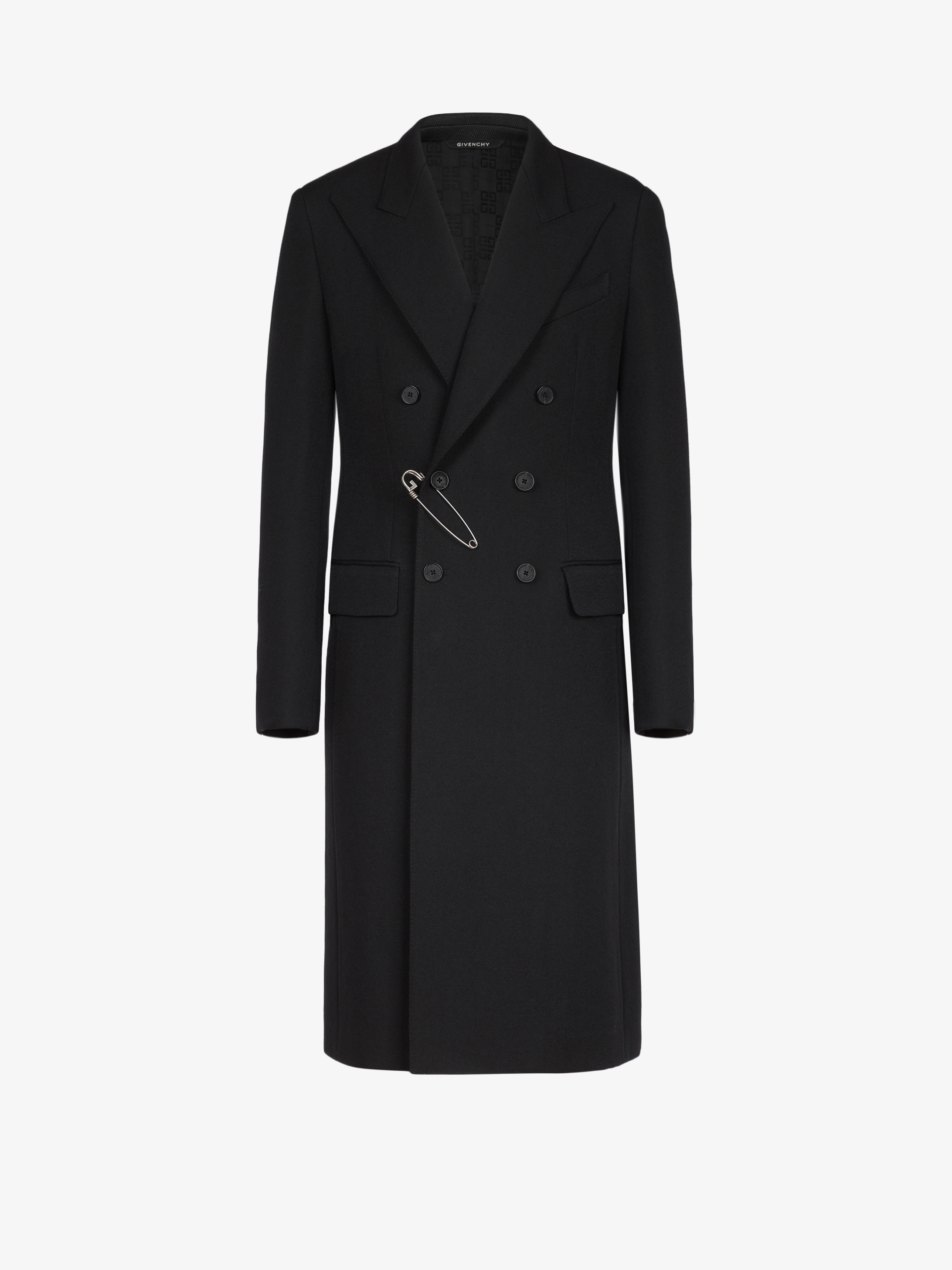 Double braisted coat in wool with G pin